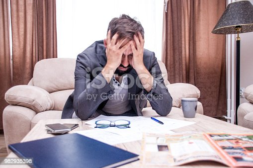 690496350istockphoto Frustrated office manager overloaded with work. 982935398