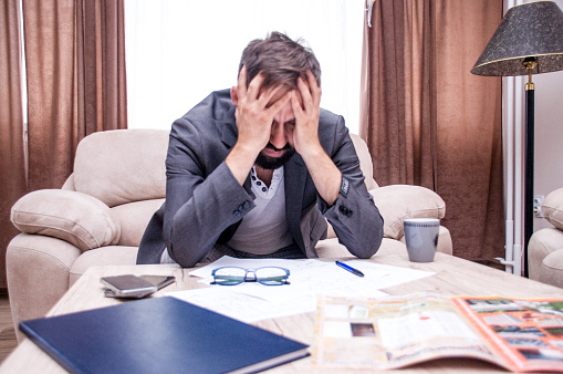 690496350 istock photo Frustrated office manager overloaded with work. 982935398