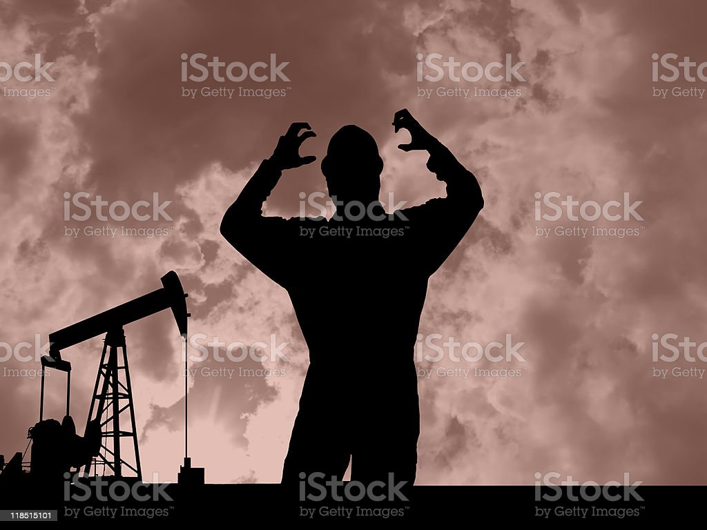 Frustrated Oil Worker and Pumpjack royalty-free stock photo