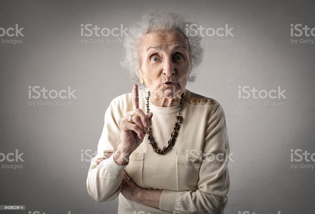 Frustrated old woman stock photo