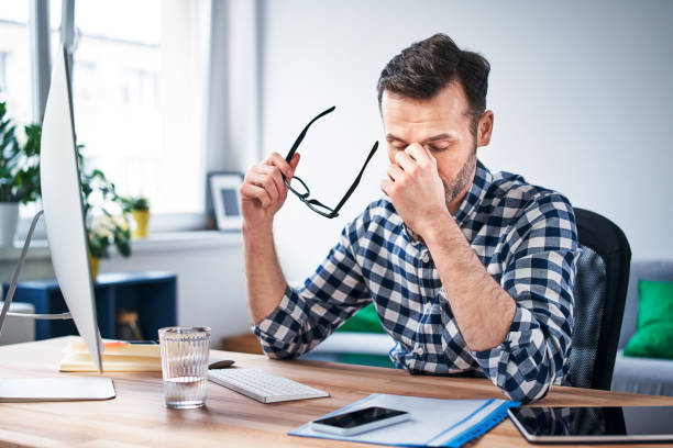 Frustrated, overworked freelancer working from home office stock photo