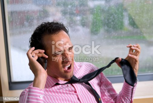 865714662 istock photo Frustrated Salesman: Young Hispanic Businessman Talking & Yelling on Phone 182900404