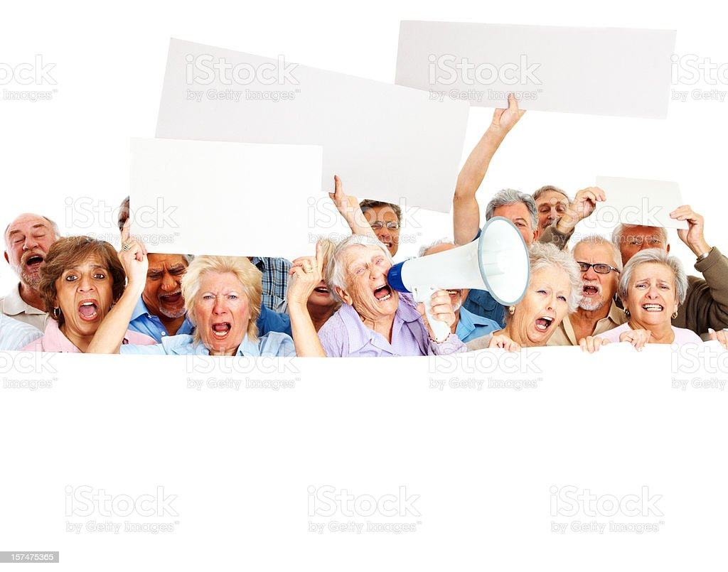 Frustrated senior people protesting with signs royalty-free stock photo