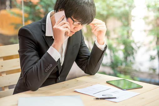 690496350 istock photo frustrated stressed business man checking chart and diagram report paper in workplace 682096462