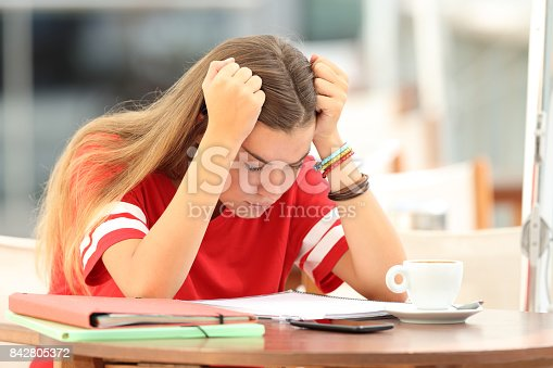 istock Frustrated student trying to understand notes in a bar 842805372