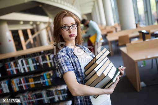 istock Frustrated teen student girl with books 915247208