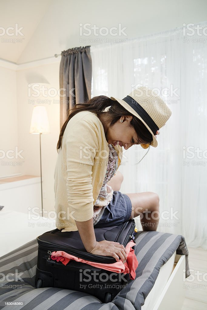 Frustrated Traveler Struggling with Suitcase in Hotel Room Vt royalty-free stock photo