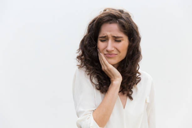 Frustrated unhappy woman suffering from toothache stock photo