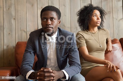 istock Frustrated upset african couple in quarrel not talking after fight 914989946