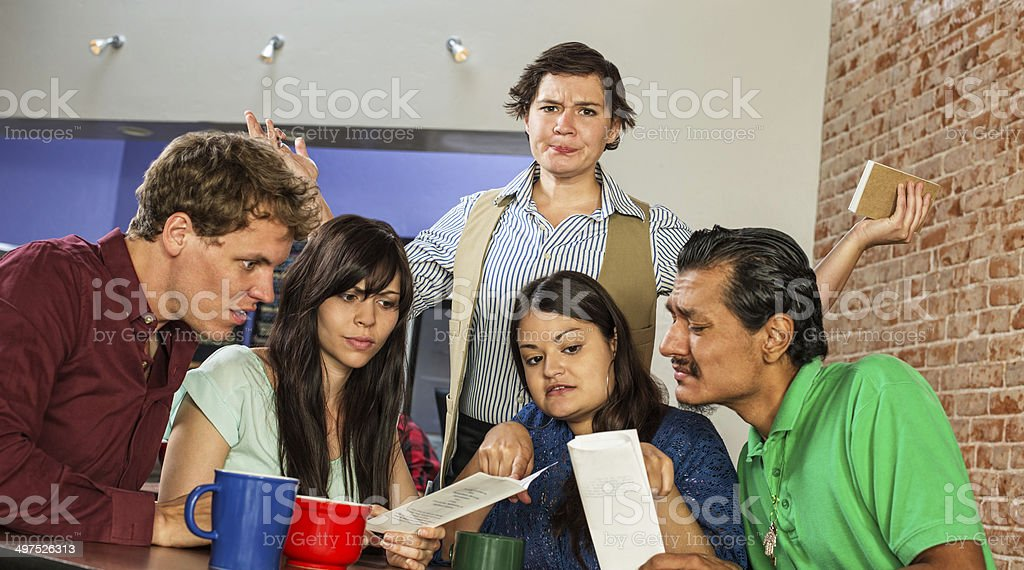 Frustrated Waitress with Customers stock photo