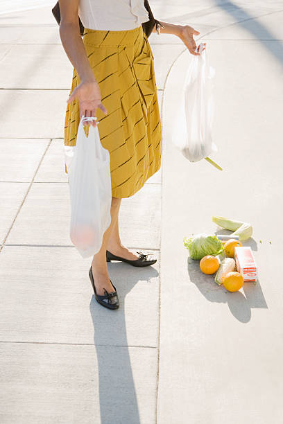 Frustrated woman dropping groceries on sidewalk  inconvenience stock pictures, royalty-free photos & images