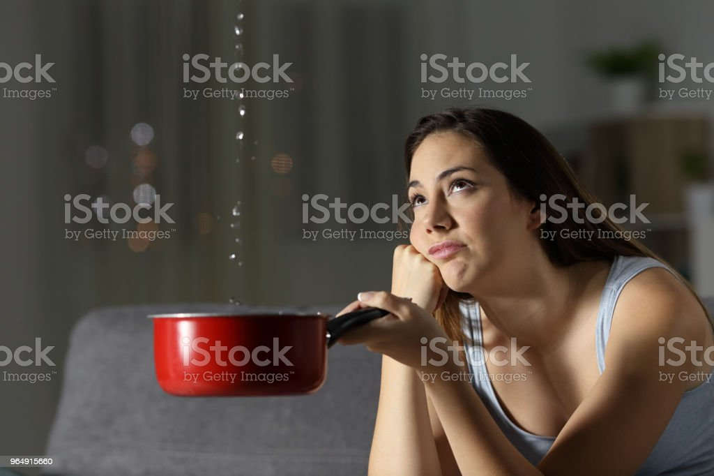Frustrated woman looking at home water leaks royalty-free stock photo