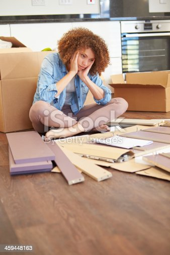 459373065 istock photo Frustrated Woman Putting Together Self Assembly Furniture 459448163