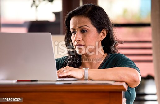 187928332 istock photo Frustrated woman reading document at home office 1218010324