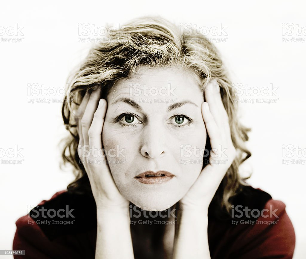 Frustrated Woman Rubbing Temples royalty-free stock photo