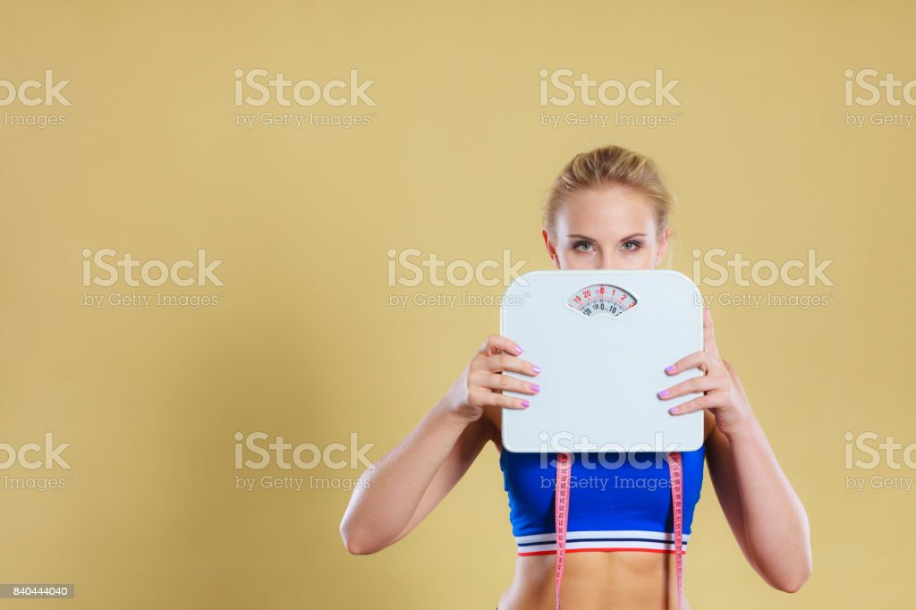 Frustrated woman unhappy with weight gain stock photo
