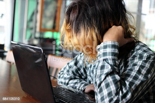833210686 istock photo Frustrated young Asian man feeling exhausted and tired his work in office 684105310