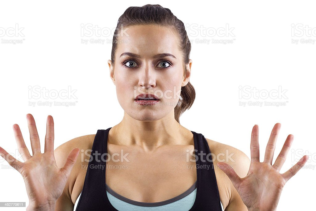 Frustrated Young Female Fitness Trainer With Her Hands Up royalty-free stock photo