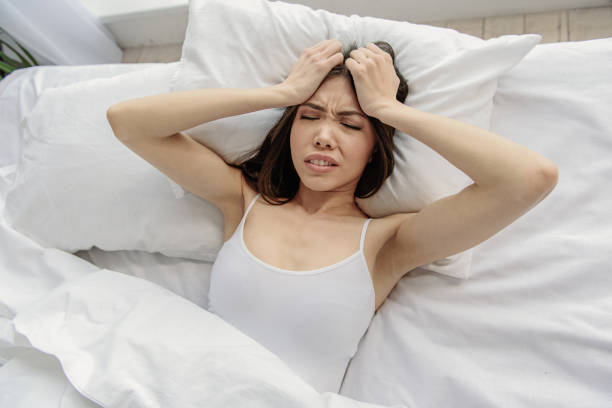 Frustrating asian woman lying in bed Bad sleep. Young female showing disappointment about dream. Disillusionment concept inconvenience stock pictures, royalty-free photos & images
