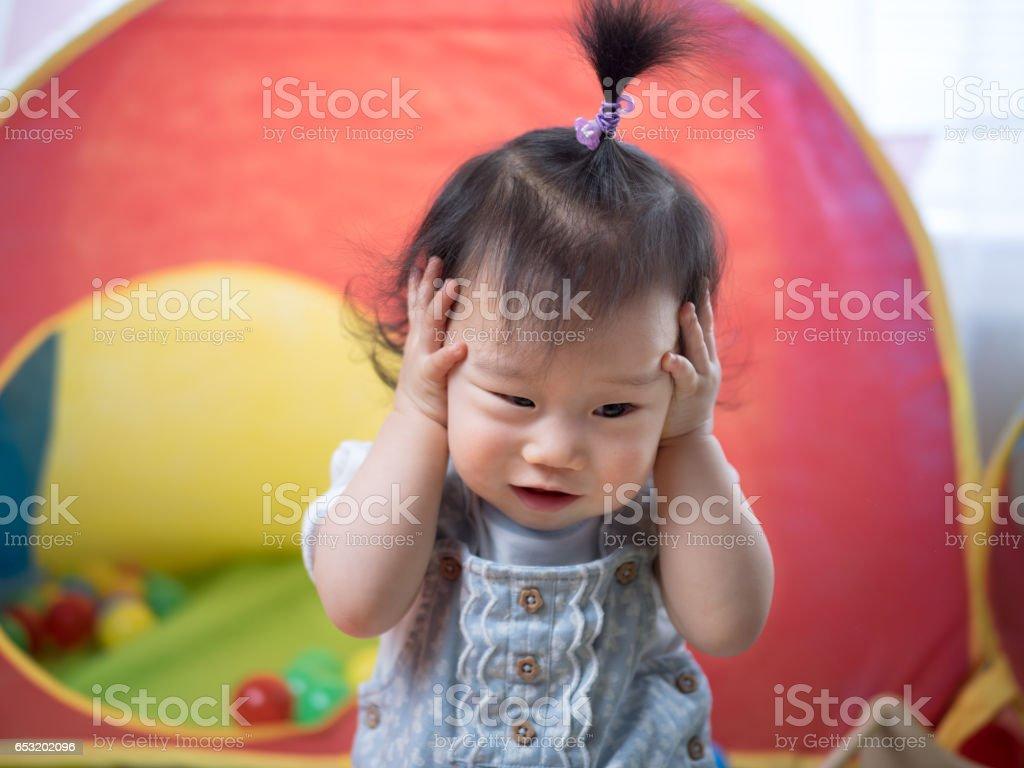 frustrating baby girl stock photo