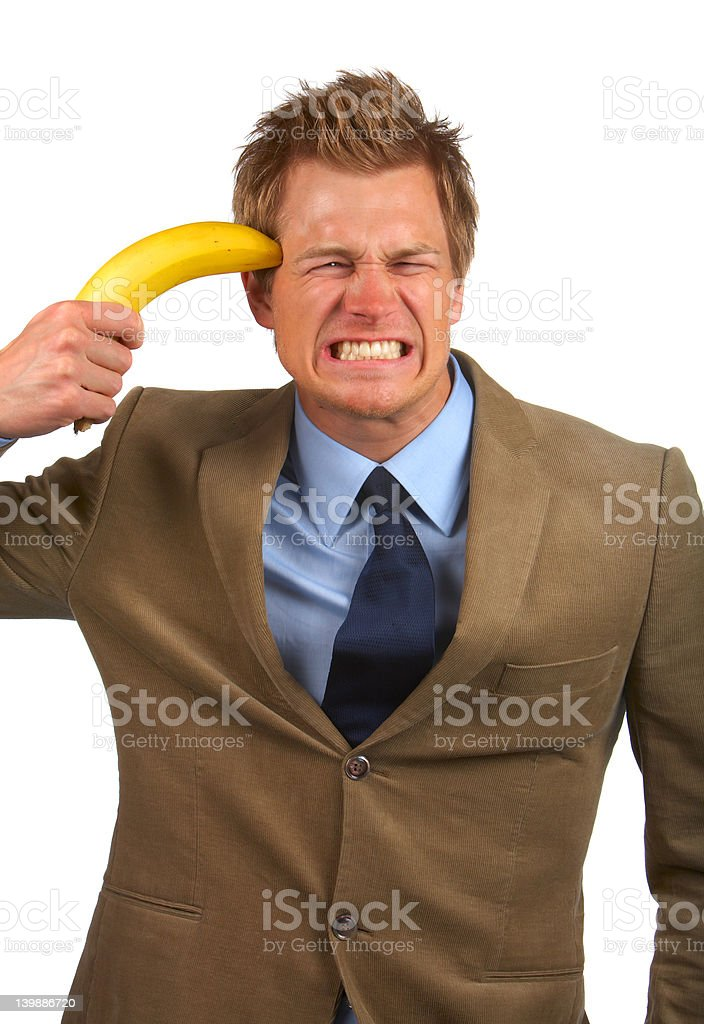 Frustration - Businessman trying to attempt suicide with banana gun Young business man trying to attempt suicide 20-24 Years Stock Photo