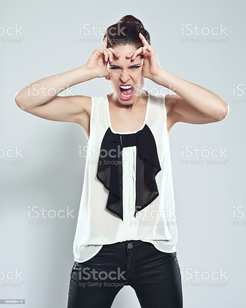 Frustration Portrait of frustrated young woman screaming . Studio shot on a grey background. 20-24 Years Stock Photo