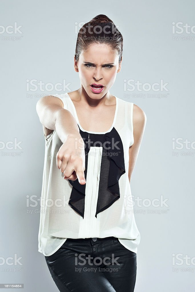 Frustration Portrait of irritated young woman scolding. Studio shot on a grey background. 20-24 Years Stock Photo