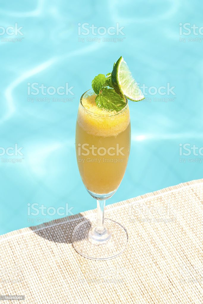 Fruttini cocktail near waterpool on the mat stock photo