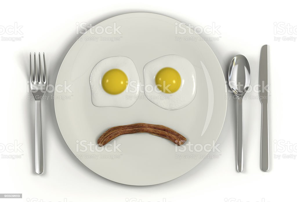 A fry making a sad face on a plate with cutlery stock photo