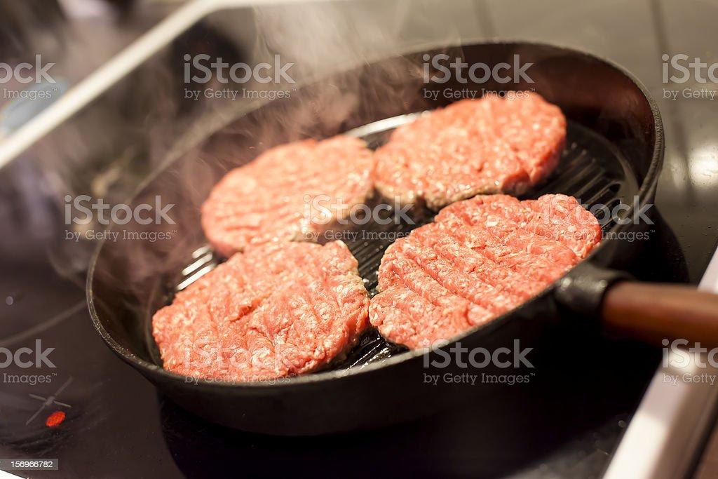Frying Hamburgers stock photo