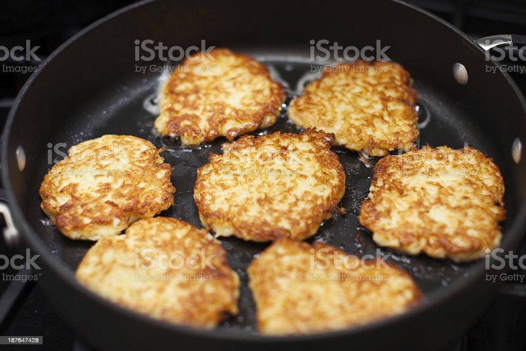 Frying Latkes stock photo