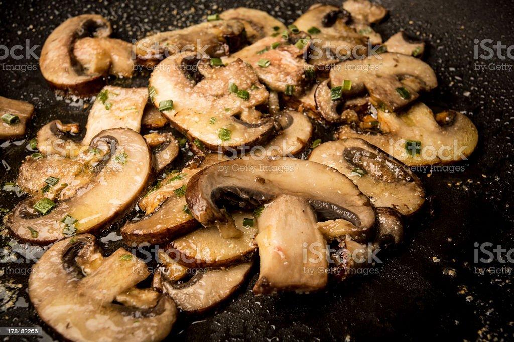 Frying Mushrooms In Saute Pan stock photo