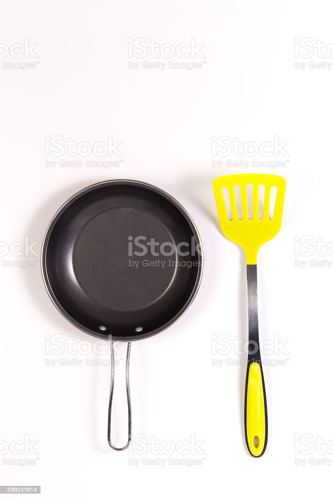 frying pan and Colorful yellow spatula with Copyspace royalty-free stock photo
