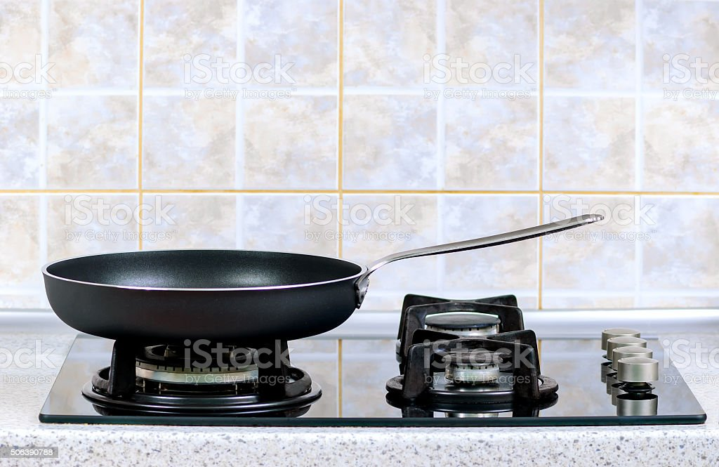 frying pan on the gas stove stock photo