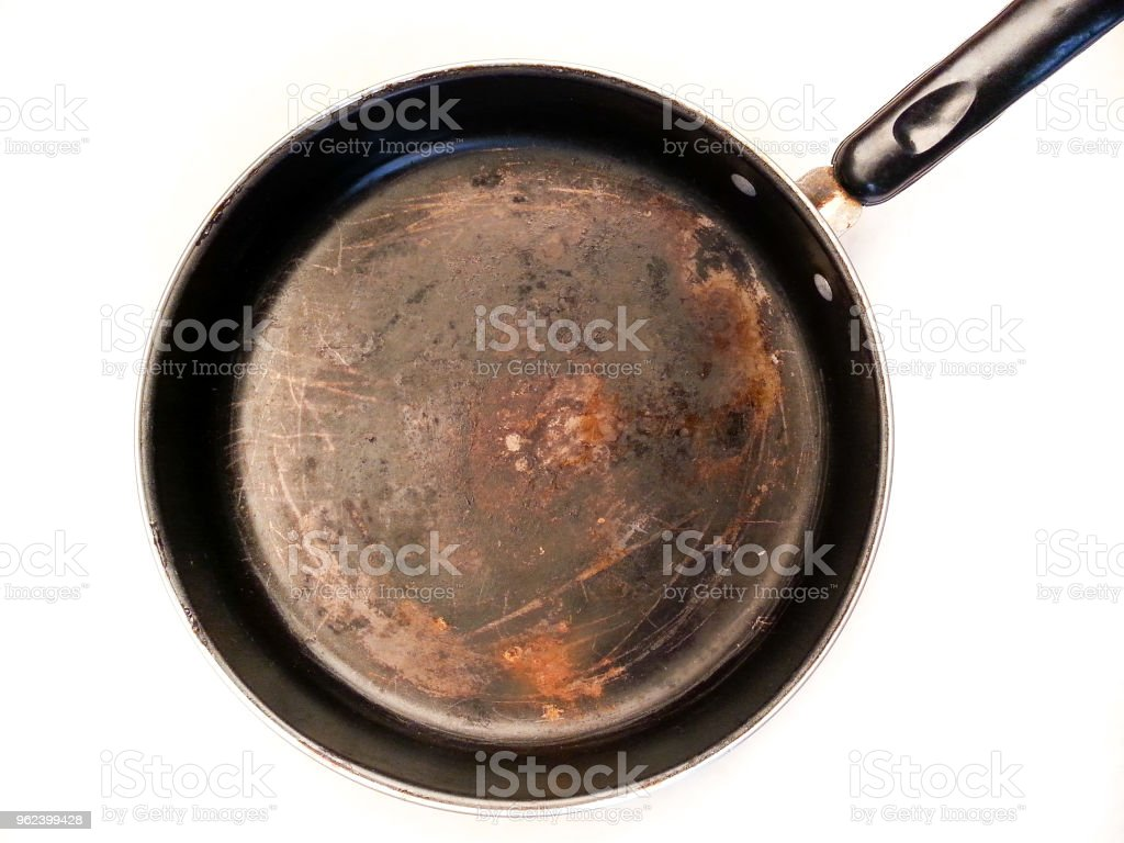 Frying pan with rust stock photo