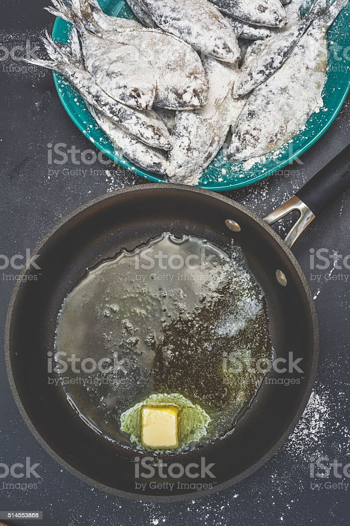 Frying Sardines stock photo