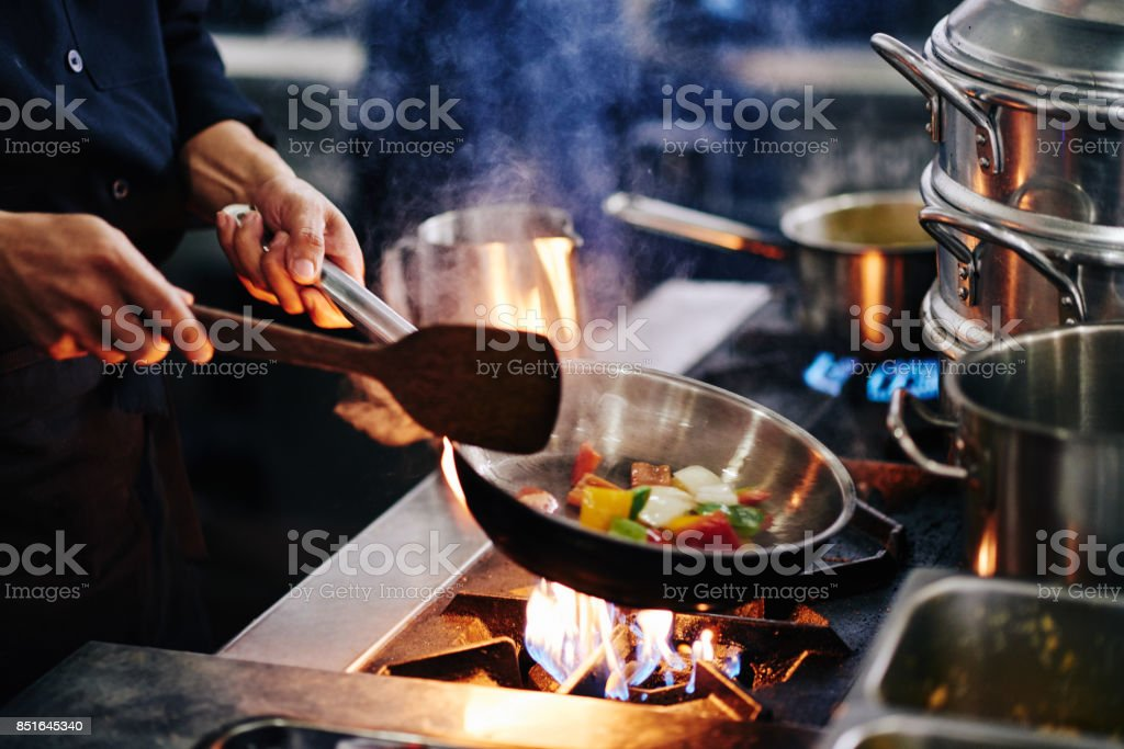 Frying vegetables stock photo