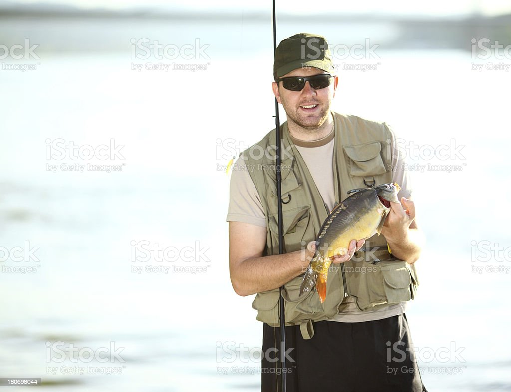 Fsiherman with his catch. royalty-free stock photo