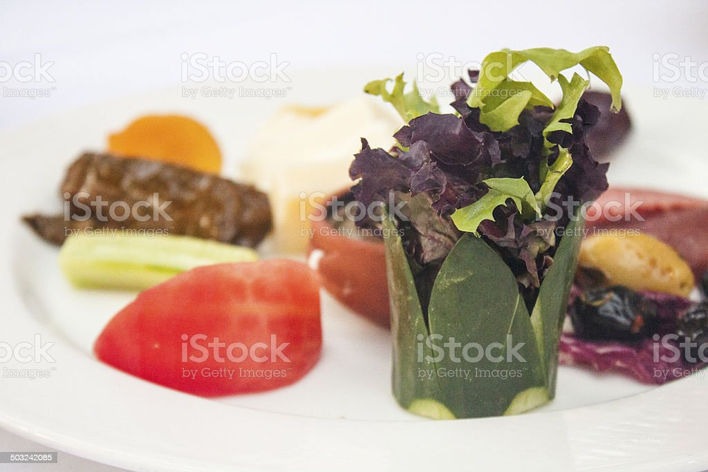 İftar plate with palm and greens stock photo