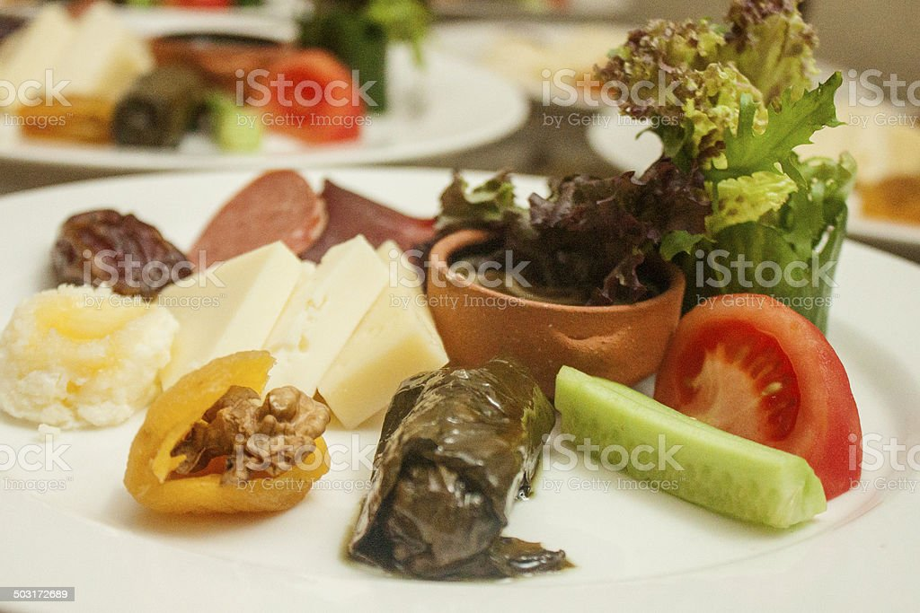 İftar plate with palm, dolmades and greens stock photo