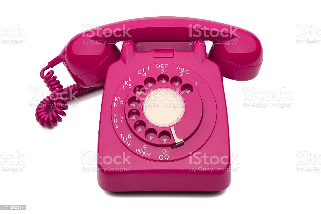 Fuchsia dial style corded desk phone royalty-free stock photo