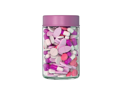 istock Fuchsia pills in the container. 900945356
