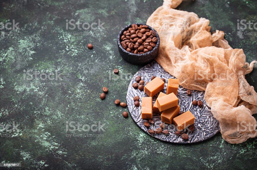 Fudge toffee candy with coffee beans stock photo