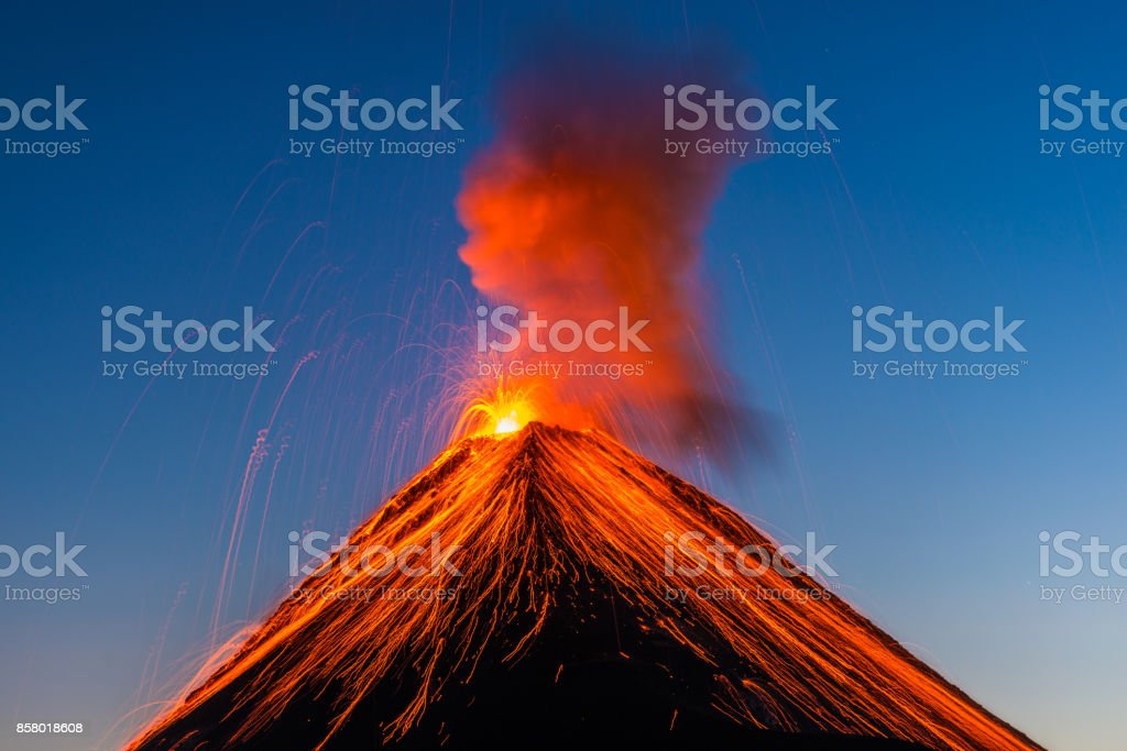 Fuego volcano eruption The Fuego volcano outside Antigua, Guatemala erupts in the early evening on Feruary 27, 2016. Beauty In Nature Stock Photo