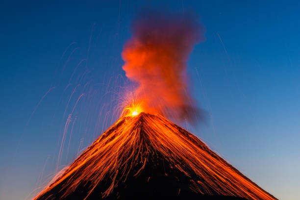 Fuego volcano eruption The Fuego volcano outside Antigua, Guatemala erupts in the early evening on Feruary 27, 2016. volcano stock pictures, royalty-free photos & images