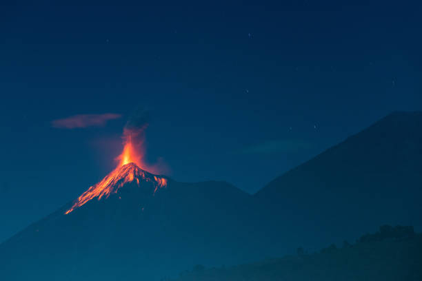 Fuego volcano eruption The Fuego volcano outside Antigua, Guatemala erupts in the early evening on February 02, 2014. volcano stock pictures, royalty-free photos & images