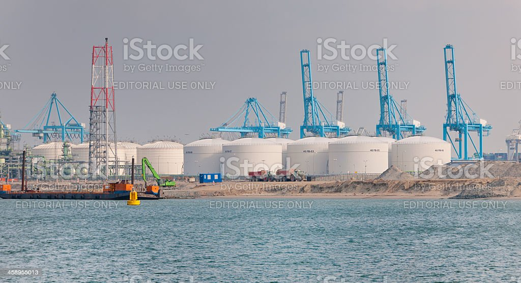fuel and gas storage tanks at waterfront on the Maasvlakte stock photo