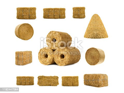 fuel briquettes of straw isolated on a white background