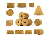 istock fuel briquettes of straw isolated on a white 1192447064