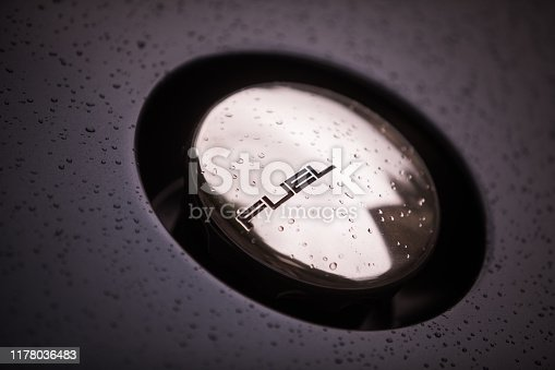 Close up shot of a fuel cap on a vintage car.